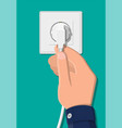 electrical outlet and hand with plug vector image vector image