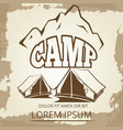 camping label with tents and mountains on vintage vector image