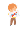 little boy showing paper with pictured plane