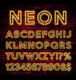 bright neon alphabet on dark brick wall background vector image