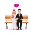 happy cute groom and bride cartoon sitting on vector image