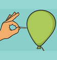 hand and needle pierces the balloon pop art design vector image vector image