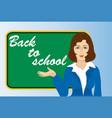 a teacher near the blackboard back to school vector image