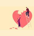 couple assembling heart symbol vector image
