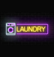 glowing neon laundry signboard on dark brick wall vector image vector image