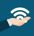 man hand holding a wifi symbol vector image