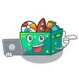 with laptop character wooden box of kids toys vector image