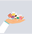 doctor hand holding different medical pills vector image