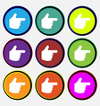 pointing hand icon sign Nine multi-colored round vector image vector image