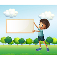 A boy holding an empty framed board vector image vector image