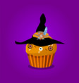 Cute happy halloween cupcake with witch hat and