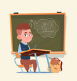 small school boy sit at desk over class board vector image vector image