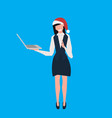 businesswoman wearing santa red hat using laptop vector image