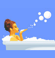 woman blowing a bubbles off her hand relaxing in vector image vector image