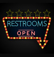 shining retro light banner restrooms on a black vector image