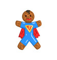 gingerbread man in costume of superman christmas vector image vector image