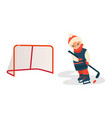 boy playing hockey with puck and stick front view vector image