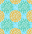 Painted orange and green dotted circles on blue vector image vector image