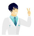 young asian doctor showing the victory gesture vector image vector image