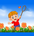 boy wearing red shirt catching butterfly vector image