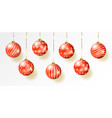 Red christmas balls on gift bows isolated