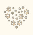 heart with brown cat or dog paw prints vector image