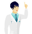 asian doctor with open mouth pointing finger up vector image vector image