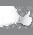 thumbs up with christmas torn paper background vector image vector image