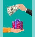 gift box and money in hand vector image vector image