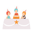 happy girl blowing candles with her friends kids vector image vector image