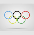 circles painted olympic rings over grey background vector image vector image