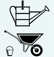 Garden wheelbarrow and watering can vector image