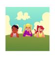 three happy children lying on green grass under vector image vector image