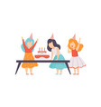 girl blowing candles with her friends kids vector image vector image