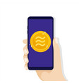 hand holding smartphone with libra coin currency vector image vector image