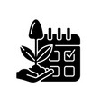 estimating planting time black glyph icon vector image vector image