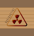 Radioactive sign on wooden background