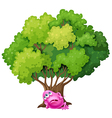 A pink monster resting under the tree vector image vector image