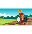A boy biking at the rocky road vector image