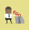 african businessman throw his ego into the trash vector image vector image
