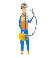 young caucasian welder holding gas welding machine vector image