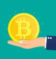 golden coin with bitcoin sign in hand vector image vector image