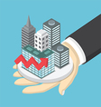 Isometric businessman hand holding the city vector image