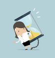 businesswoman carrying huge sand hourglass vector image
