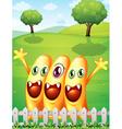 Three happy orange monster near the fence vector image vector image