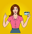 young woman with bank card pop art vector image