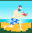 bearded man holding big red crab with claws on sea vector image