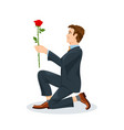 man is kneeling with a flower in his hand view vector image vector image