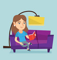 young caucasian woman reading a book on sofa vector image vector image