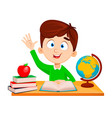 back to school cute boy sitting at table vector image